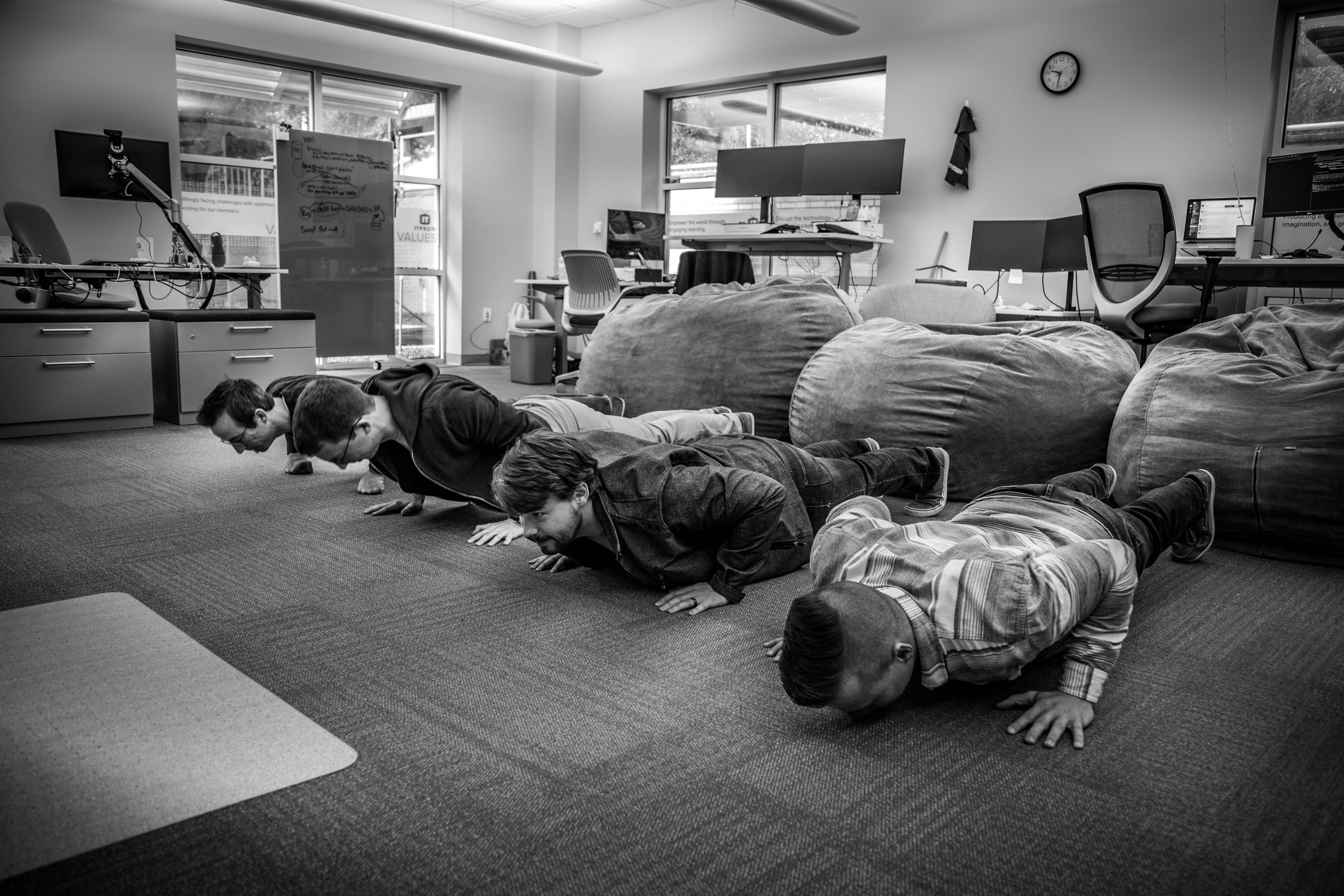 A photo of ITProTV Team doing push ups